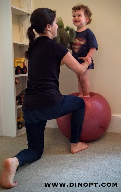 kid on pilates ball